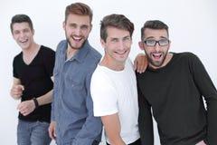 Группа в составе люди разнообразия стоя совместно в команде стоковое изображение