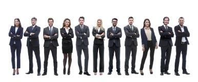 Группа в составе молодые успешные предприниматели стоя в ряд стоковые фото