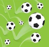 Группа в составе отскакивать футбольные мячи Стоковые Изображения