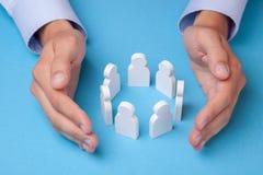 Группа в составе работники Как держать команду работников Страхование работников стоковая фотография rf