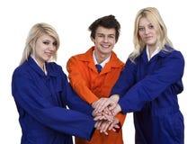 Группа в составе руки молодых людей совместно стоковая фотография