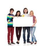 Группа в составе студенты с пустым знаменем Стоковая Фотография