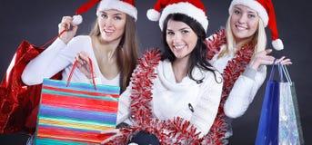 Группа в составе счастливые женщины в костюмах Санта Клауса и рождества sh Стоковое Изображение