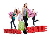 Группа в составе счастливые женщины с хозяйственными сумками Стоковое фото RF