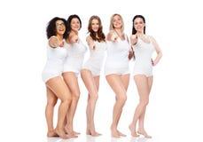 Группа в составе счастливые различные женщины указывая на вас Стоковые Изображения RF
