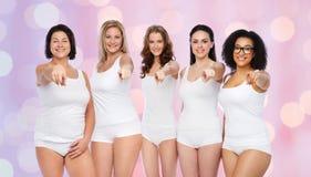 Группа в составе счастливые различные женщины указывая на вас Стоковые Фотографии RF