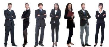 Группа в составе успешные бизнесмены стоя в ряд стоковые изображения rf