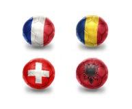 Группа a евро шарики футбола с национальными флагами Франции, Румынии, Швейцарии, Албании Стоковая Фотография