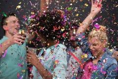 Группа людей партии Confetti многонациональная стоковая фотография rf