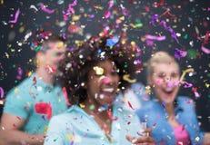Группа людей партии Confetti многонациональная стоковые изображения