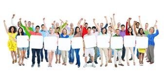 Группа людей проводя 10 пустых плакатов Стоковые Фото
