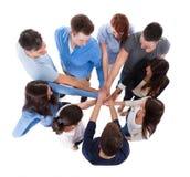 Группа людей штабелируя руки совместно Стоковые Фотографии RF