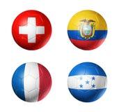 Группа e кубка мира 2014 Бразилии сигнализирует на футбольном мяче Стоковое фото RF