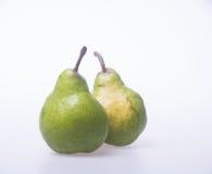 груши или 2 зеленых груши на предпосылке Стоковое Изображение