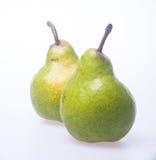 груши или 2 зеленых груши на предпосылке Стоковые Изображения