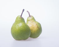 груши или 2 зеленых груши на предпосылке Стоковое Фото
