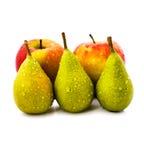 Груши и яблоки. На белой предпосылке Стоковые Изображения RF