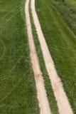 Грязная улица отслеживает траву Стоковое Изображение RF