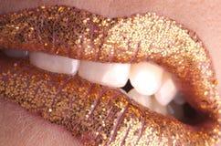 губа золота укуса ваша Стоковое Изображение