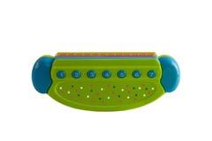 Губная гармоника, аккордеон, губная помада детей, пластмасса изолированная на белой предпосылке Стоковое Изображение RF