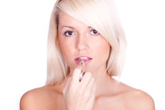 губная помада девушки Стоковая Фотография