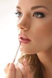 Губная помада девушки на белизне Стоковая Фотография RF