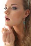 Губная помада девушки на белизне Стоковая Фотография