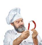 Главный кашевар держа 2 перца chili Стоковое Фото