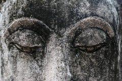 Глаза конца статуи Будды вверх Стоковая Фотография RF