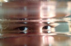 Глаза через стекло Стоковая Фотография