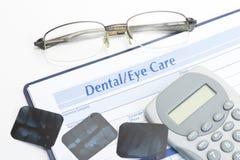 Глаз и зубоврачебный показатель стоковые фото
