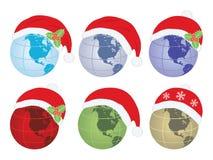 Глобусы с шляпой Санта Клауса Стоковые Фотографии RF