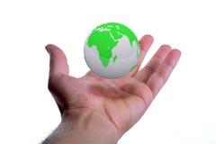 Глобус в руке стоковые фотографии rf