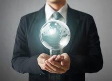 Глобус в людской руке Изображение земли обеспеченное NASA Стоковое Изображение