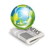 Глобус земли на изолированной газете Бесплатная Иллюстрация