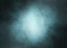 Глубокая cyan предпосылка дыма с светом в центре Стоковое фото RF