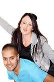 давать женщину езды piggyback человека Стоковое Изображение RF