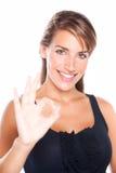 дает одобренную милую женщину знака Стоковое фото RF
