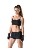 Дама фитнеса выреза показывая торс стоит и смотрит сразу на камере Стоковое фото RF