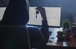 Данные по загрузки взломщика компьютера от цифрового прибора стоковая фотография rf