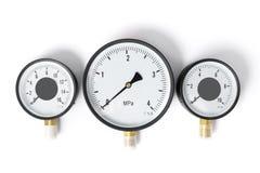 Датчик давления в трубопроводе манометр 3 датчика различных размеров на белизне изолировали предпосылку Стоковые Изображения RF