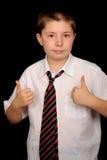 дающ большие пальцы руки школьника вверх Стоковые Изображения