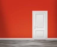 Дверь в красной предпосылке стены Стоковые Изображения