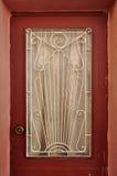 Дверь с абстрактной картиной солнца Стоковая Фотография