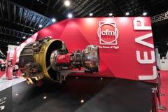 Двигатель ПЕРЕСКАКИВАНИЯ CFM на дисплее на Сингапуре Airshow Стоковое Фото