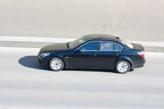 движение автомобиля предпосылки запачканное чернотой Стоковое Изображение RF