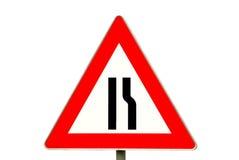 движение дорожного знака сужения стоковая фотография rf