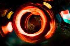 Движение круга высокого разрешения абстрактное накаляя запачкало предпосылку в темная яркая красной, зеленый, желтый, голубой Стоковое Изображение