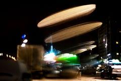 Движение круга высокого разрешения абстрактное накаляя запачкало предпосылку в темная яркая красной, зеленый, желтый, голубой Стоковая Фотография RF