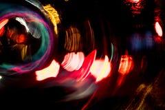 Движение круга высокого разрешения абстрактное накаляя запачкало предпосылку в темная яркая красной, зеленый, желтый, голубой Стоковое Фото